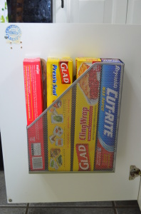 Another great idea for re-purposing a magazine rack that makes use of completely dead space! From The Wandmaker's Mother