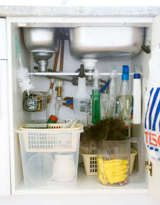 """What a simple idea that makes use of every inch of cabinet space! Install a tension rod to hang spray cleaners to free up the """"floor space"""" in the cabinet. Genius! Via A Thousand Words"""