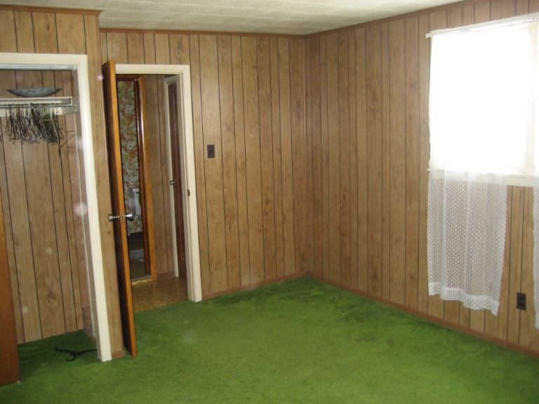 Home buyers do NOT love wood paneling, as a general rule. It screams of decades past (and not in a good way). Image Via UglyHousePhotos.